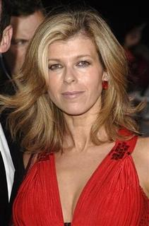 GMTV presenter Kate Garraway poses at the ''National Television Awards'' at the Royal Albert Hall in London October 31, 2007. Garraway is to sue two newspapers for libel over a ''sad, hurtful and totally untrue'' story about her relationship with her teacher on ''Strictly Come Dancing''. REUTERS/Anthony Harvey