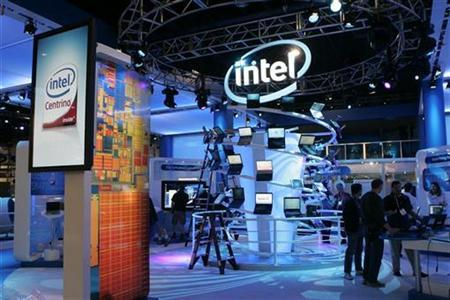Workers prepare an Intel booth for the Consumer Electronics Show (CES) in Las Vegas, January 6, 2008. The European Commission conducted antitrust raids against Intel Corp's Munich offices on Tuesday and against retailers selling products of the world's largest chip maker, the Commission and the chip maker said. REUTERS/Steve Marcus