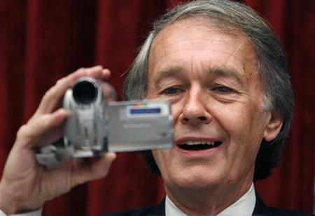 House Subcommittee on Telecommunications and Internet Chairman Rep. Edward Markey makes his own video of witnesses and the audience to upload to the Internet site ''You Tube'' during a hearing on Capitol Hill in Washington, May 10, 2007. REUTERS/Kevin Lamarque