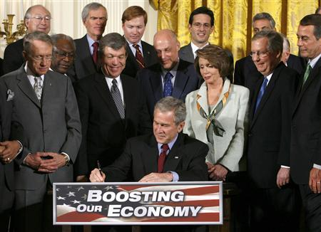 President George W. Bush signs H.R. 5140, the Economic Stimulus Act of 2008, at the White House in Washington February 13, 2008. REUTERS/Kevin Lamarque