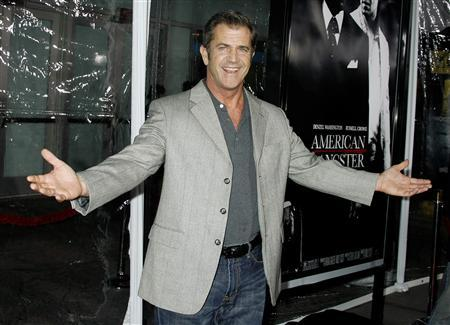 Actor Mel Gibson arrives at the Los Angeles premiere of the film ''American Gangster'' in Hollywood, California in this October 29, 2007 file photo. Gibson, who made worldwide news by unleashing an anti-Semitic tirade during his 2006 arrest for drunk driving, received a judge's approval on February 12, 2008 to serve the rest of his probation without appearing in court again. REUTERS/Fred Prouser/Files