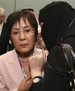 Yakin Erturk, the Human Rights Council's special rapporteur on violence against women, (L) speaks to a journalist after a news conference in Riyadh February 13, 2008. REUTERS/Fahad Shadeed