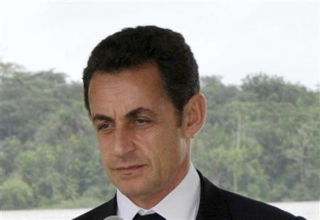 France's President Nicolas Sarkozy attends a news conference with Brazil President Luiz Inacio Lula da Silva in Saint Georges de l'Oyapock in French Guiana February 12, 2008. REUTERS/Philippe Wojazer