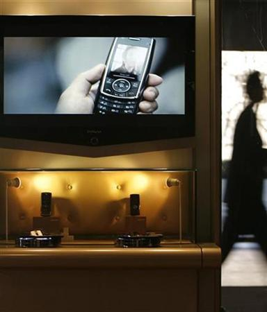 A man walks out of an exhibition hall where cell phones are on display in Seoul January 15, 2008. REUTERS/Lee Jae-Won