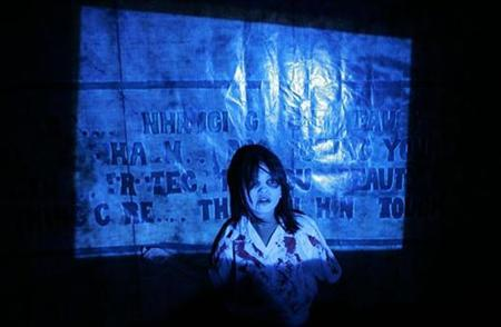 A mock ghost scares people entering a ''haunted school'' during a Halloween celebration at a mall in Manila October 31, 2007. REUTERS/Cheryl Ravelo