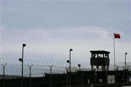 A guard tower of Camp Delta is seen at the Guantanamo Bay Naval Station in Guantanamo Bay, Cuba September 4, 2007. The Bush administration appealed to the U.S. Supreme Court on Thursday in an effort to limit the information it must provide when Guantanamo Bay prisoners challenge their continued captivity. REUTERS/Joe Skipper/Files