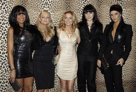 Pop group Spice Girls (L-R) Mel B, Emma Bunton, Geri Halliwell, Mel C, and Victoria Beckham pose for the photographers before the Roberto Cavalli's Fall/Winter 2008/09 men's collections during Milan Fashion Week January 14, 2008 REUTERS/Alessandro Garofalo