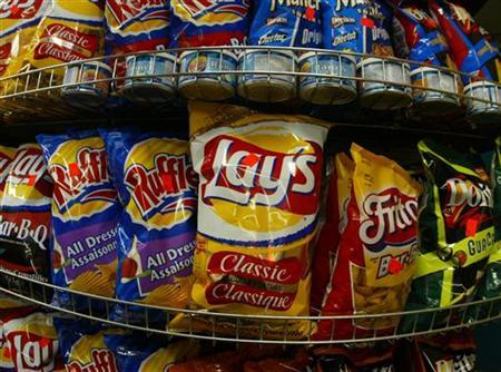 Frito Lays snacks are seen in a Montreal grocery store, February 24, 2004. Many snack foods and spreads on the market are now free of artery-clogging trans fat, but consumers still need to be savvy label-readers, according to researchers.REUTERS/Shaun Best