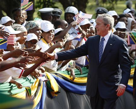 President Bush greets wellwishers during an arrival ceremony at the State House in Dar es Salaam, Tanzania, February 17, 2008. REUTERS/Jason Reed
