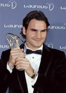 Swiss tennis player Roger Federer holds the Laureus Sportsman of the Year award at the Mariinsky Theatre in St Petersburg February 18, 2008. REUTERS/Alexander Demianchuk