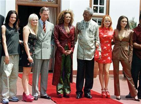 Spice Girls, Mel C (L), Emma, (2L) Mel B (C) Gerri, (2R) and Victoria (R) pose with President Nelson Mandela and Prince Charles in Pretoria, (3L) November 1, 1997. REUTERS/Peter Andrews