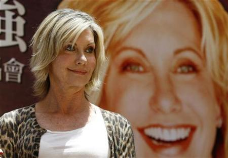 Australian singer Olivia Newton-John holds a news conference to promote her Asia concert tour in Taipei April 20, 2007. Newton-John plans to walk along the Great Wall of China to raise money for a cancer charity, with celebrities from around the world planning to join the trek, she told reporters on Tuesday. REUTERS/Richard Chung