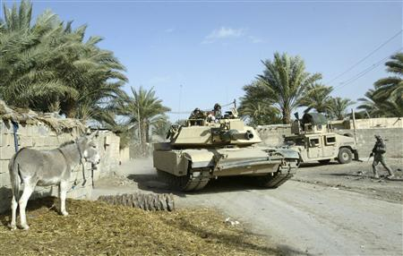 U.S. forces patrol on a road in Yousifiya in south Baghdad February 19, 2008. Iraq's military said eight policemen were killed in eastern Baghdad on Tuesday as they tried to defuse a series of rockets that had been prepared for an attack. REUTERS/Ibrahim Sultan