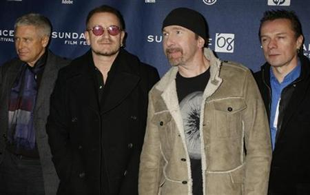 Members of the band U2 (L-R) Adam Clayton, Bono, The Edge and Larry Mullen pose for photographers as they arrive for the premiere of ''U2 3D'' the first digital 3D concert film by directors Catherine Owens and Mark Pellington at the 2008 Sundance Film Festival in Park City, Utah in this file photo from January 19, 2008. REUTERS/Fred Prouser