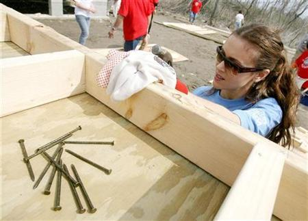 Actress Alyssa Milano hammers on a house frame as she helps build homes with Habitat for Humanity during the NBA Cares All-Star Day of Service in New Orleans, Louisiana February 15, 2008. As thousands of U.S. homes sit empty with no buyers, Habitat for Humanity is looking to work with banks and others to help get more lower-income families into affordable housing, the nonprofit group's chief executive said on Tuesday. REUTERS/Sean Gardner
