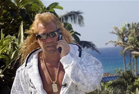 Duane ''Dog'' Chapman takes a call at his home in Honolulu, Hawaii January 16, 2007. REUTERS/Lucy Pemoni