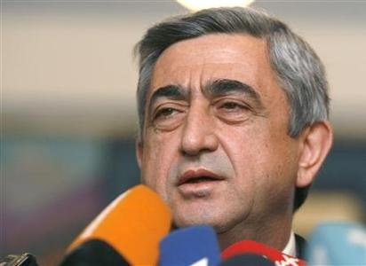 Armenia's Prime Minister and presidential candidate Serzh Sarksyan speaks to the media after casting his ballot at a polling station in Yerevan, February 19, 2008. REUTERS/David Mdzinarishvili