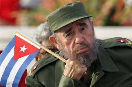 Cuban President Fidel Castro listens to a speaker during the May Day parade on Havana's Revolution Square, May 1, 2005. REUTERS/Claudia Daut