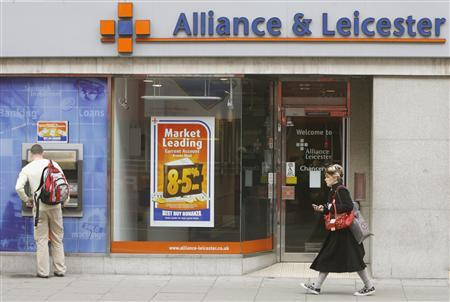A woman passes an Alliance and Leicester bank in central London February 20, 2008. REUTERS/Luke MacGregor