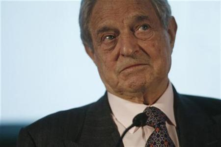 George Soros, founder of the Open Society Institute, listens to a questin following his keynote address at the InterAction 2007 forum in Washington, April 18, 2007. The philanthropic units of billionaire investor Soros and Google have put $17 million into a venture with the Omidyar network to fund small and medium enterprises in India, they said in a statement. REUTERS/Jason Reed