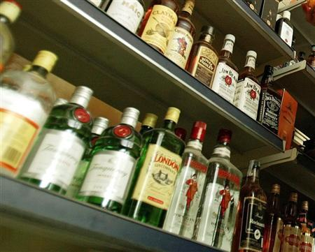 Bottles of alcohol sit on shelves in an undated file photo. Liquor makers in central China's Henan province are planning a legal challenge to fight a ban on Communist Party officials and civil servants drinking alcohol at lunch during work days, state media said on Wednesday. REUTERS/Zohra Bensemra