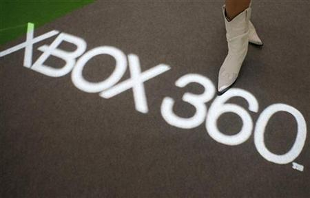 A model stands at Microsoft Corp.'s Xbox 360 display at the Tokyo Game Show in Chiba, east of Tokyo September 20, 2007. Microsoft Corp announced late on Wednesday it will cut the prices of its Xbox 360 video-game consoles as it continues to battle Nintendo's Wii and Sony's PlayStation 3 for dominance of the gaming market. REUTERS/Issei Kato