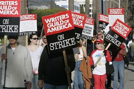 Members of the Writers Guild of America carry signs on the picket line at NBC studios in Burbank, California February 8, 2008. REUTERS/Fred Prouser