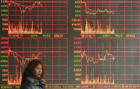 An investor walks past an electronic board showing stock information at a brokerage house in Suining, Sichuan province, February 21, 2008. REUTERS/Stringer
