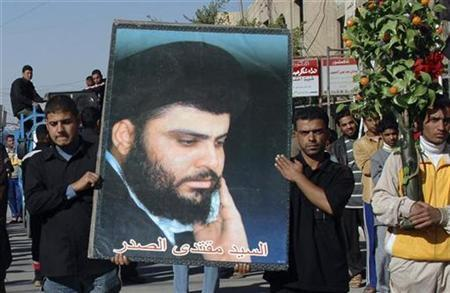Supporters of Shi'ite cleric Moqtada al-Sadr display his poster during a rally in Baghdad, November 26, 2007. Sadr is expected to extend a six-month ceasefire by his Mehdi Army militia, two senior officials in his movement confirmed for the first time on Thursday. REUTERS/Ahmed Malik