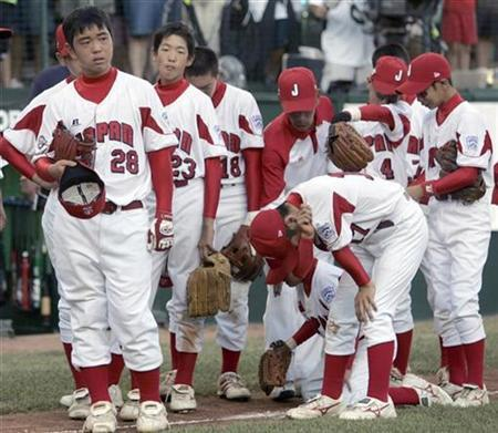 Tokyo Japan team members react after losing to Warner Robins Georgia in the final game of the Little League Baseball World Series in Williamsport, Pennsylvania August 26, 2007. A boy with measles who was on the Japanese team in last year's Little League World Series triggered a U.S. outbreak of the disease that sickened at least six other people, health officials said on Thursday. REUTERS/Tim Shaffer