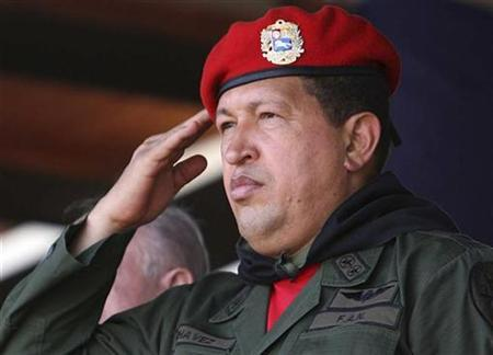 Venezuela's President Hugo Chavez salutes during a military parade to celebrate the 16th anniversary of a failed coup d'etat led by him in 1992, in Valencia, 160 km (99 miles) from Caracas, February 4, 2008. REUTERS/Ho-Miraflores Palace