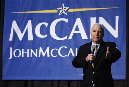 Republican presidential candidate John McCain answers a listener's question at a town hall meeting in Indianapolis February 22, 2008. REUTERS/Brent Smith