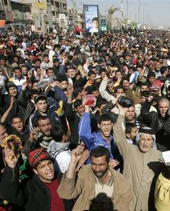 Demonstrators chant slogans during a protest in Baghdad's Sadr City February 22, 2008. REUTERS/Kareem Raheem
