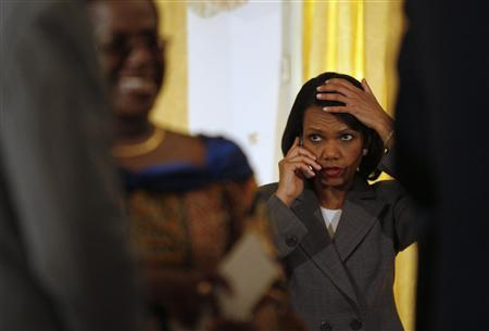 Secretary of State Condoleezza Rice talks on a mobile phone during a visit by U.S. President George Bush (not pictured) at Osu Castle in Accra February 20, 2008. REUTERS/Jason Reed