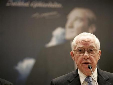 U.S. Attorney General Michael Mukasey addresses the media in Ankara, February 15, 2008. REUTERS/Umit Bektas
