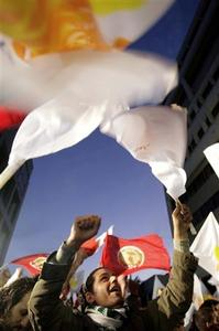 Supporters of Communist presidential candidate Demetris Christofias celebrates after first results were announced in Nicosia February 24, 2008. REUTERS/Yiorgos Karahalis