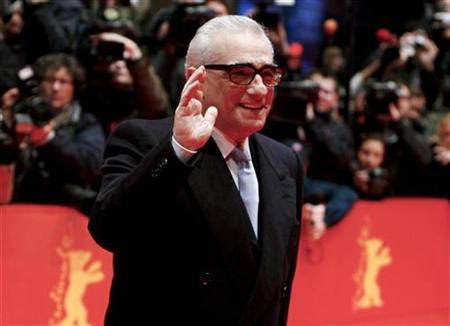Director Martin Scorsese waves at the red carpet as he arrives for the screening of the opening film 'Shine A Light' running in competition at the 58th Berlinale International Film Festival in Berlin February 7, 2008. Emily Mortimer and Jackie Earle Haley will play mental patients in the mystery drama ''Shutter Island,'' Scorsese's latest collaboration with Leonardo DiCaprio. REUTERS/Johannes Eisele