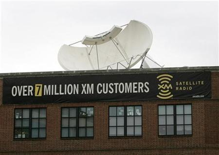A satellite dish sits atop the headquarters of XM Satellite Radio in Washington February 20, 2007. Sirius Satellite Radio Inc, whose proposed purchase of rival XM Satellite Radio is still awaiting regulatory approval, reported a smaller quarterly loss on Tuesday as subscribers to its pay-radio service increased. REUTERS/Jason Reed