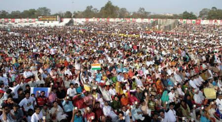People gather for a tea party at a stadium in Indore in this handout photograph dated February 24, 2008. More than 32,000 people sipped their way into a new world record as India hosted the world's largest tea party in Indore. REUTERS/Handout