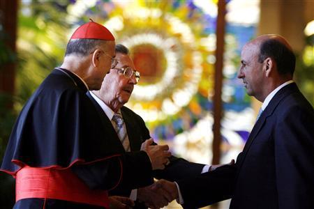 Vatican Secretary of State Cardinal Tarcisio Bertone (L) and Cuba's President Raul Castro (L-rear) greet Cuba's Vice President Carlos Lage at the Revolution Palace in Havana February 26, 2008. REUTERS/Javier Galeano/Pool