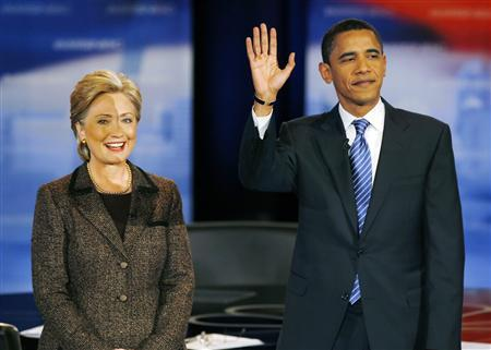 U.S. Democratic presidential candidates Senator Hillary Clinton (D-NY) and Senator Barack Obama (D-IL) pose before the last debate before the Ohio primary in Cleveland, Ohio, February 26, 2008. REUTERS/Matt Sullivan