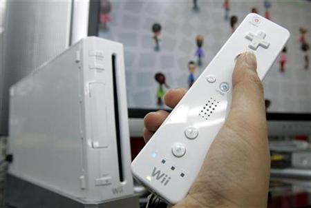 Nintendo Co's Wii game console is displayed at an electronic shop in Tokyo's Akihabara district January 24, 2008. Nintendo's Wii game console outsold Sony Corp's PlayStation 3 nearly 4-to-1 in Japan in February as Wii software titles dominated the best seller list, a game magazine publisher said. REUTERS/Yuriko Nakao