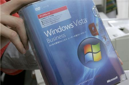 A salesman holds Microsoft Corp's Windows Vista operating system on the day of its debut at an electronics retail shop in Tokyo, January 30, 2007. Microsoft Corp <MSFT.O> said on Thursday it plans to cut prices of its Windows Vista operating system sold at retail outlets in a move aimed at pushing customers to switch to the newest version of Windows. REUTERS/Toru Hanai