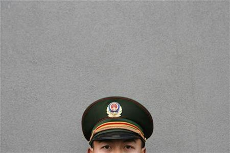 A Chinese soldier guards the entrance to the Nanjing massacre museum before a ceremony marking the event's 70th anniversary in Nanjing December 13, 2007. China and the United States formally agreed on Friday a long-planned hotline to improve communication between their two militaries, the official Xinhua news agency reported. REUTERS/Nir Elias