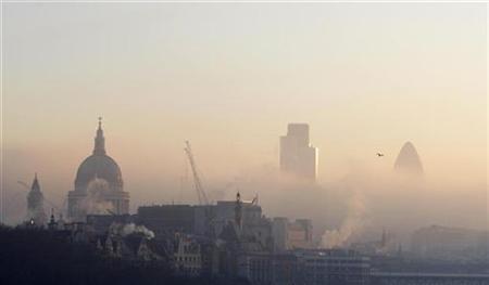 London's skyline is seen through the morning fog from Waterloo Bridge in London February 11, 2008. REUTERS/Kieran Doherty