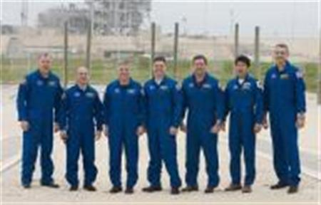 The crew of the space shuttle Endeavour STS-123 (L to R) commander Dominic Gorie, mission specialist Garrett Reisman, pilot Gregory H. Johnson, mission specialist's Robert Behnken, Mike Foreman, Takao Doi of the Japan Aerospace Exploration Agency and Rick Linnehan assemble for a photo near launch pad 39A at Kennedy Space Center in Cape Canaveral, Florida February 24, 2008. NASA managers on Friday cleared the U.S. space shuttle Endeavour for lift-off on March 11 on the first of three flights to deliver a huge Japanese research complex to the International Space Station. REUTERS/Scott Audette