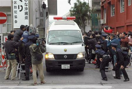A van carrying U.S. Marine Tyrone Hadnott leaves a police station as he is transferred to prosecutors in Okinawa February 12, 2008. REUTERS/Kyodo