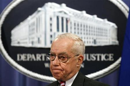 U.S. Attorney General Michael Mukasey listens during a news conference at the Justice Department in Washington December 11, 2007. REUTERS/Kevin Lamarque