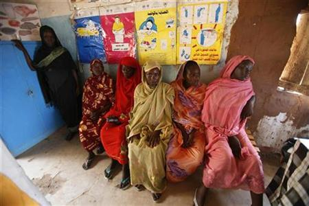 Pregnant women wait to have a medical check-up at the Mayo camp for internally displaced persons in Khartoum September 6, 2007. Hundreds of thousands of women in poor countries die each year during pregnancy or childbirth from largely avoidable causes, MPs said on Sunday. REUTERS/Zohra Bensemra