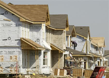 Houses under construction in a suburb of Chicago in a file photo. The depth of the housing crisis hasn't been hit yet if a new study by several prominent economists is correct concluding that unless financial markets can quickly recapitalize, banks are likely to cut back their lending to consumers and businesses by nearly $1 trillion. REUTERS/John Gress